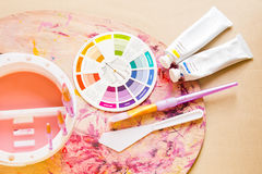 Colour Wheel and Painting Accessories Royalty Free Stock Photos