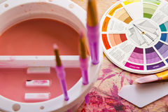 Colour Wheel and Painting Accessories Stock Photo