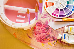 Colour Wheel and Painting Accessories Stock Photography