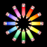 Colour wheel pencils. A circle of coloured pencils forming a colour wheel on a black background Royalty Free Stock Image