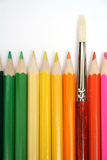 Colour wooden pencils around of an art brush. 2 Royalty Free Stock Photo
