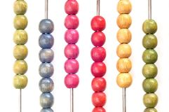 Coloured abacus. Closeup of bright abacus beads on white background Royalty Free Stock Images