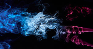 Coloured abstract smoke. Isolated on balck background Stock Photos