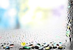 Coloured background. Coloured water drops on glass Royalty Free Stock Images