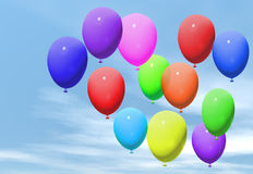 Coloured balloons. Floating in a blue sky Stock Photography