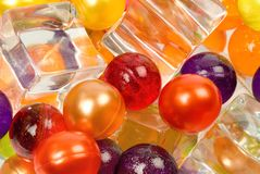 Coloured balls and ice cubes. Many-coloured balls and ice cubes abstraction Stock Image