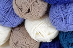 Coloured balls of wool. Blue, cream and beige coloured balls of wool royalty free stock image