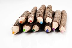 Coloured bark pencils. Coloured pencils made from bark pointing into the camera stock photography