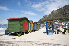 Coloured beach huts and children's playground Stock Photography