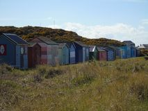 Coloured beach huts. Under Scottish summer skies stock photos