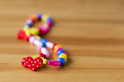 Coloured bead on the wood table Stock Images