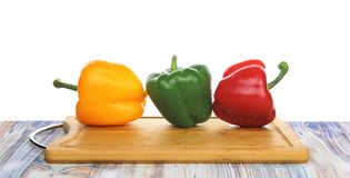 Bell peppers on a chopping board royalty free stock images