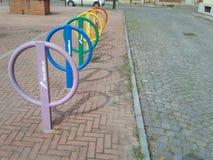 Coloured bike rails in Collegno. COLLEGNO, ITALY - CIRCA MARCH 2017: coloured bike rails royalty free stock image