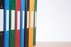 Coloured biurowe dokument falcówki na szelfowym zbliżeniu Obraz Royalty Free