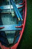Coloured boat. Coloured red-blue boat in backwater Stock Photo