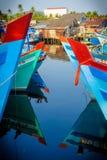 Coloured boats on phu quoc island,vietnam. Coloured boats moored at harbour on phu quoc island,vietnam Stock Photo