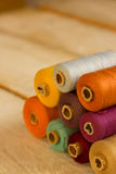 Coloured bobbins stock images