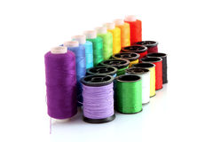 Coloured bobbins of thread isolated Stock Photo