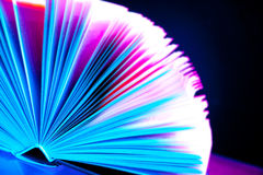 Coloured book on black. Overexposed big coloured book with hard cover at 10Mps Stock Images