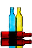 Coloured Bottles Reflected in a Mirror royalty free stock photo
