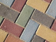 Coloured brick pavement Stock Photos