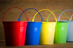 Coloured buckets on the floor Royalty Free Stock Photos