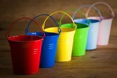 Coloured buckets on the floor royalty free stock photos