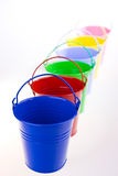 Coloured buckets in line stock photography