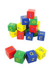 Letter and number blocks. Colorful cubes or blocks with letters of the alphabet and numbers.  One arrangement spells the word play Royalty Free Stock Photos