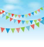 Coloured bunting. On a sky background Stock Photo