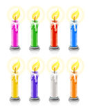 Coloured burning holiday candles Royalty Free Stock Images