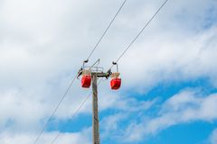 Coloured cable cars. Which climb the great Orme Mountain Stock Images