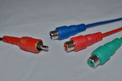 Coloured cables disconnected. Disconnected cables of blue, red and green colours royalty free stock photos