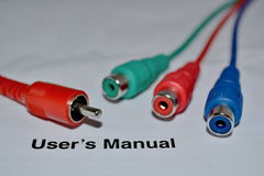 Coloured cables disconnected. Disconnected cables of blue, red and green colours a user manual text royalty free stock photos