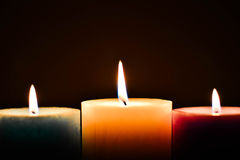 Coloured Candles with  Flame Stock Photo