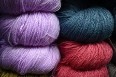 The coloured cashmilon wool stacked in the store. Close up picture of colourful wool as stacked in the shelve of a shop during winter stock images