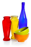 Coloured ceramic cups, glass bottle and vases Stock Photography