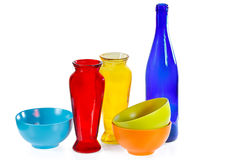 Coloured ceramic cups, glass bottle and vases Royalty Free Stock Photography