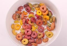 Coloured cereal with milk , breakfast meal. Delicious cereals coloured cereals with milk in bowl Breakfast meal white dish White background stock images