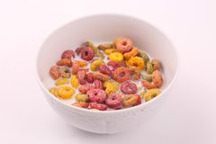 Coloured cereal with milk , breakfast meal. Delicious cereals coloured cereals with milk in white bowl Breakfast meal white dish White background royalty free stock photos