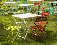 Coloured chairs white table Royalty Free Stock Images
