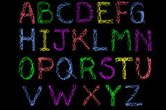 Coloured chalk handwritten alphabet on blackboard Royalty Free Stock Photo
