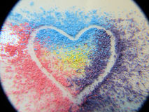 Coloured chalk heart. Heart outline in coloured shaving of multi coloured chalk stock photo