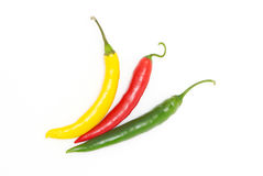 Coloured chili peppers Royalty Free Stock Images
