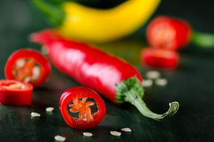 Coloured chillis Stock Photos