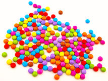 Coloured chocolate candy on a white backgrou Stock Photos