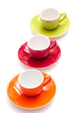 Coloured coffee mugs. Three coloured coffee mugs in orange, red and green royalty free stock images