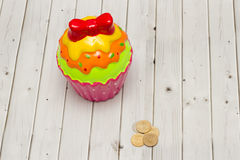 Coloured cookie piggy bank Royalty Free Stock Photo