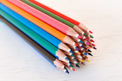 Coloured crayons on a white background. Bunch of coloured crayons on a white background Royalty Free Stock Photography