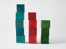 Coloured Cubes on White Background. Blue, red and green stacked coloured wooden cubes isolated on white background Stock Image